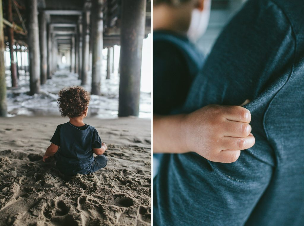 Little Boy sitting in the sand beneath the Santa Monica Pier, Southern California family photography by Birchblaze.