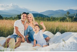 Young family enjoying New Hampshire's White Mountains on a blanket. North Conway Family Photographers, Birch Blaze Studios.