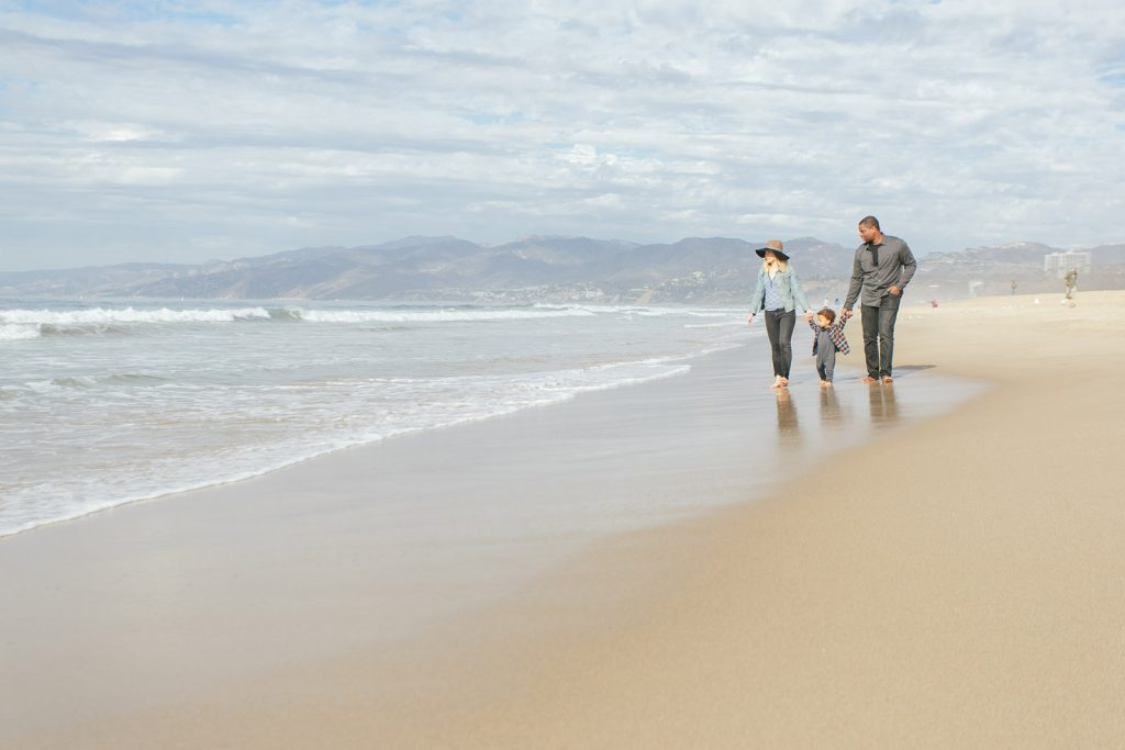 Young family on a southern California beach in Santa Monica. Family photography by Birchblaze