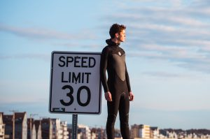 Surfer by speed limit sign. Birch Blaze Studios.