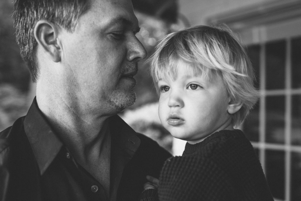 Black & white photo, little boy with his Dad. Family lifestyle photography by Birch Blaze.