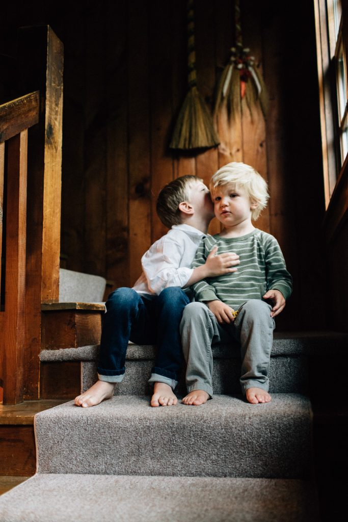 Photo of 2 young brothers snuggling, Lake Winnipesaukee family photographers, Birch Blaze.