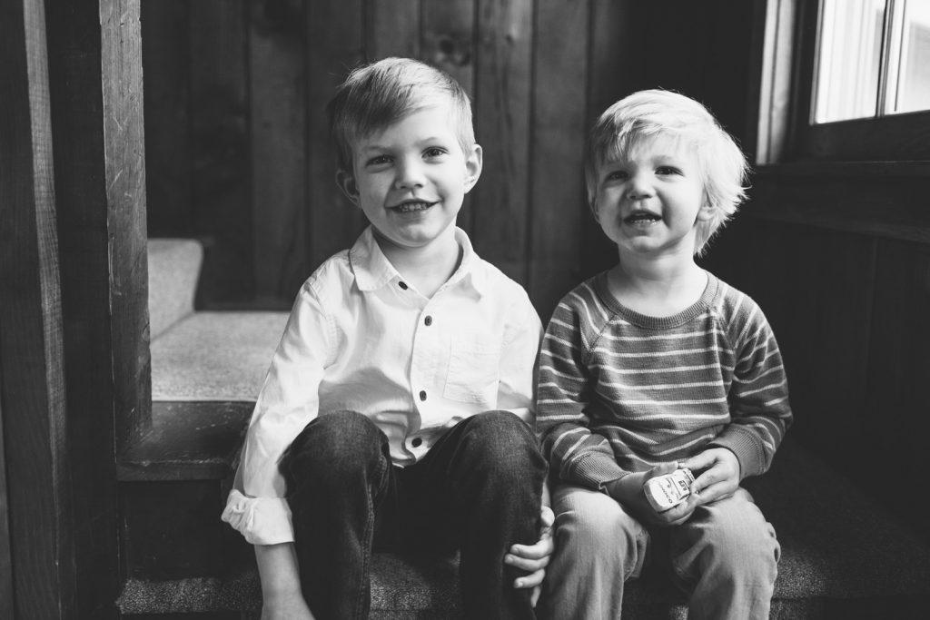 Black & white photo of 2 young brothers, Lake Winnipesaukee family photographers, Birch Blaze.