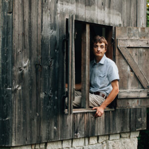 Southern Maine senior photography by Birch Blaze Studios. A young man's rustic senior portrait in Maine.