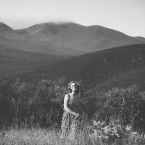 Young woman's mountain meadow, senior portrait session in Jackson, NH. Senior photos in the White Mountains by Birch Blaze Studios. B&W. © 2021 Birch Blaze Studios.