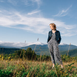 Young woman's mountain meadow, senior portrait session in Jackson, NH. Senior photos in the White Mountains by Birch Blaze Studios. © 2021 Birch Blaze Studios.